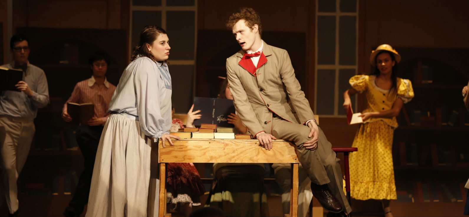 Two student actors perform their lines on stage