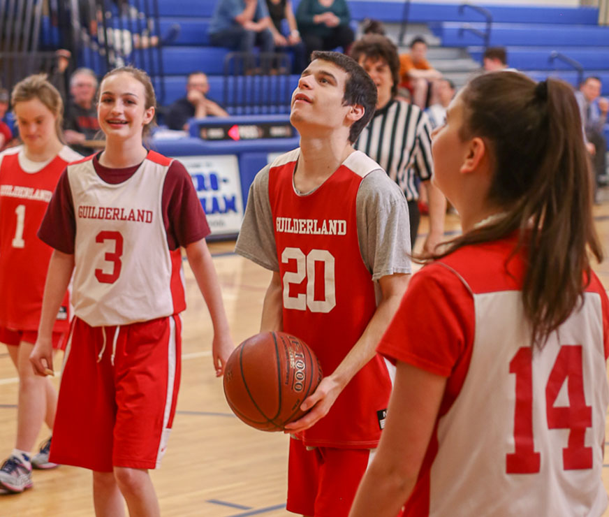 Three members of the GHS Unified Basketball team play offense