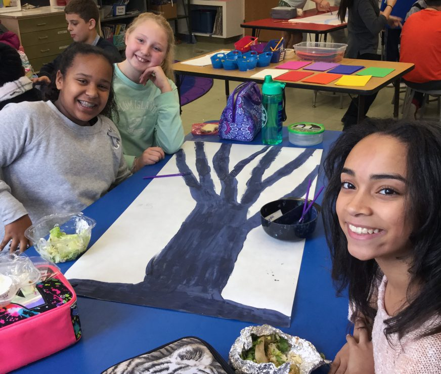 Three students take an art class break for a smile