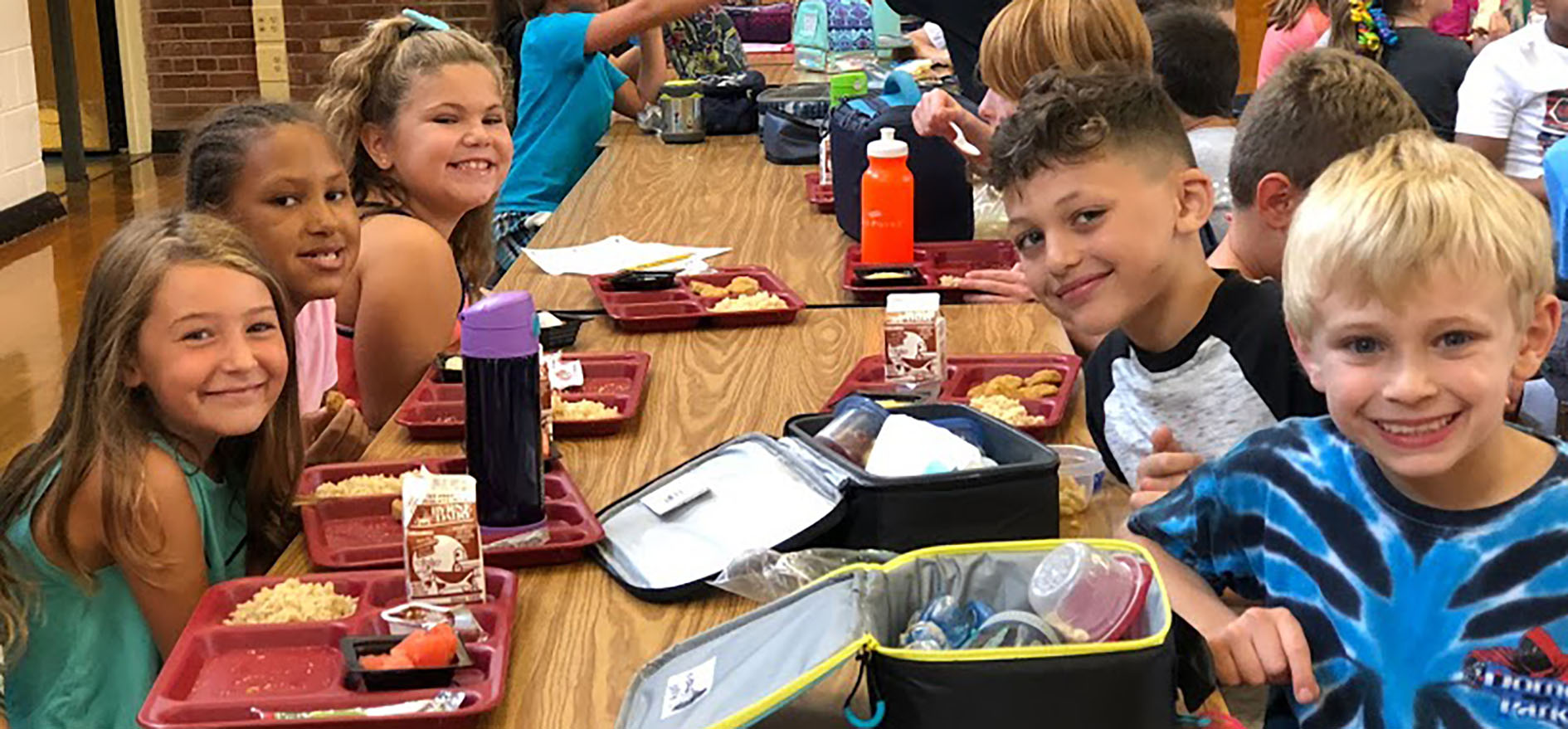 Students take a break from lunch for a smile