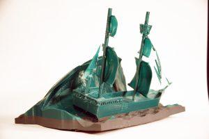 Student sculpture of a green ship