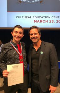 Colin poses with award presenter
