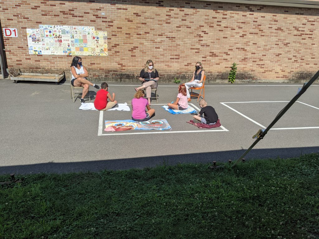 students learning outside safely