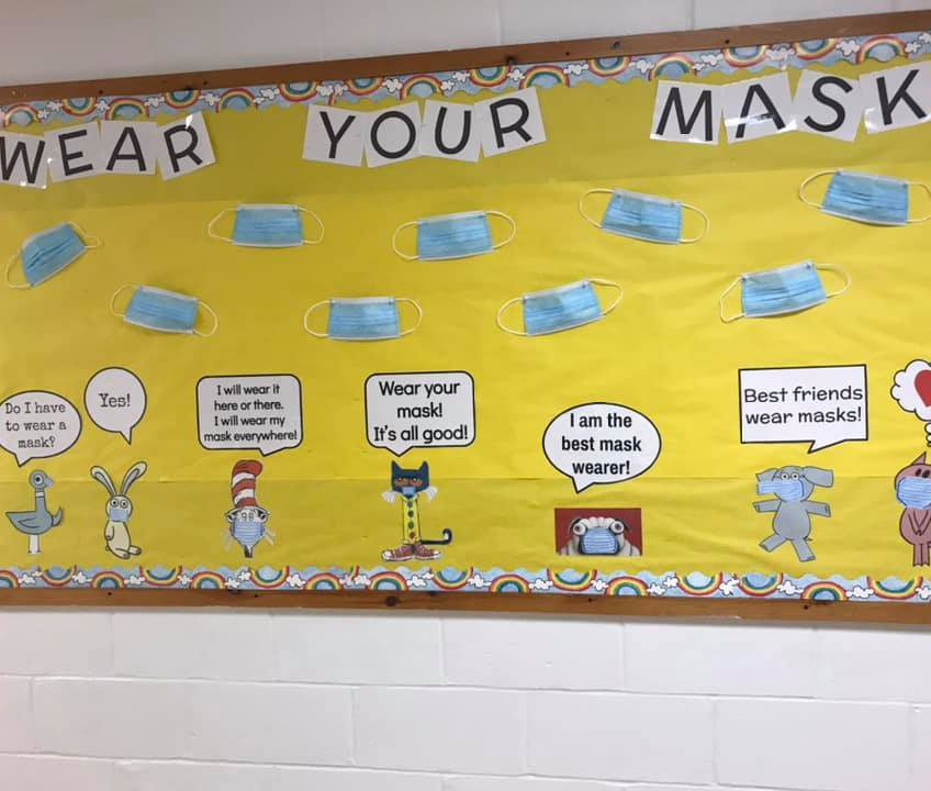 Wear Your Mask Bulletin Board with various characters in WES Hallway