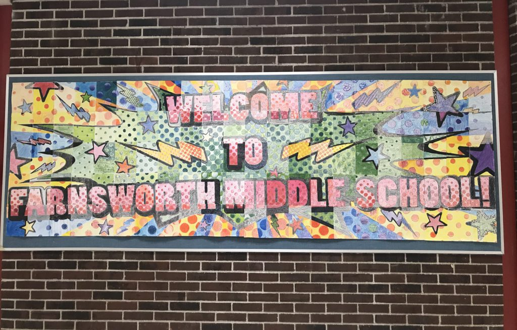 """Colorful """"Welcome to Farnsworth Middle School"""" bulletin board in the hallway"""