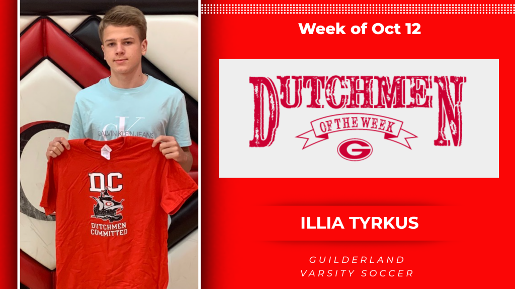 Picture of Illia Tyrkus holding Dutchmen t-shirt for th award
