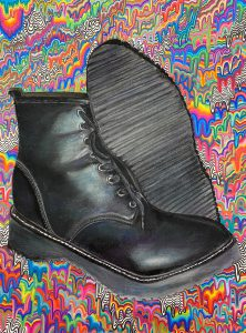 Renee Manzella Art work of black boots with colorful background