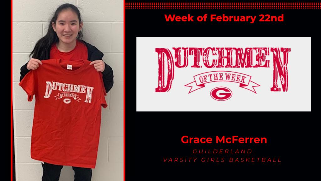 Grace McFerren holding the Dutchment of the Week Award t-shirt