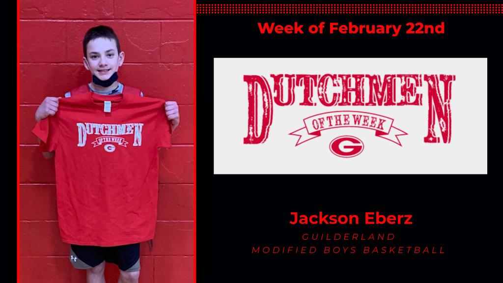 Jackson Eberz holding Dutchment of the Week Award t-shirt