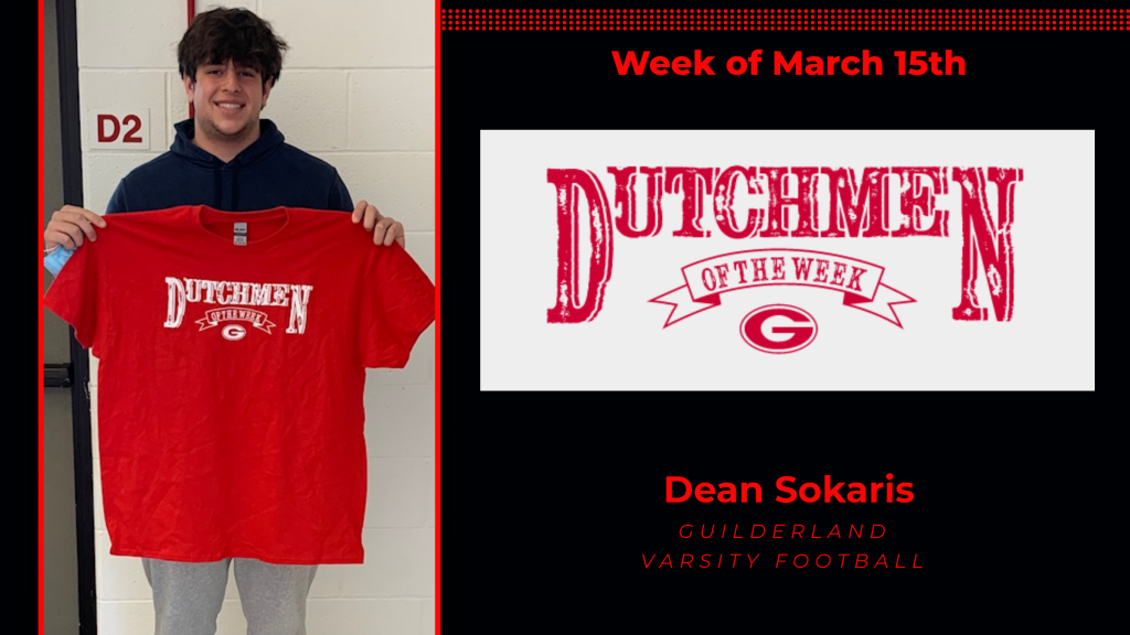 Dean holding the Dutchmen of the Week Award red t-shirt