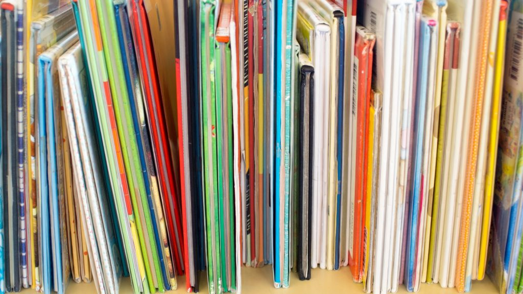 Photo of the bottom of colorful books lined up